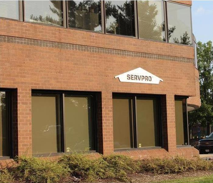 picture of brick office building with SERVPRO signage our front.